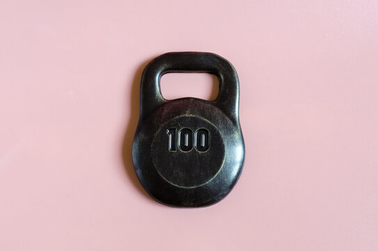 dark brown chocolate mass with the number 100 on a pink background close-up concept
