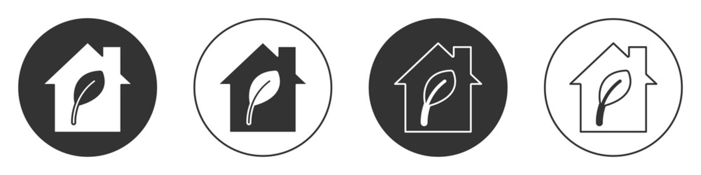 Black Eco friendly house icon isolated on white background. Eco house with leaf. Circle button. Vector