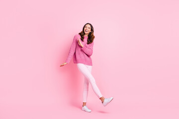 Full size photo of hooray cool brunette lady dance wear pink sweater trousers sneakers isolated on pastel pink color background