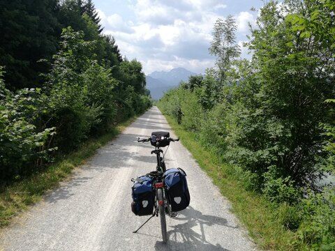 Always straight ahead. A fully packed touring bike on the way to the mountains.