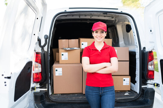 Delivery young woman making eye contact while working