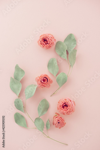 Flowers composition made of rose flowers and eucalyptus branches. Mother's day card. Flat lay, top view.