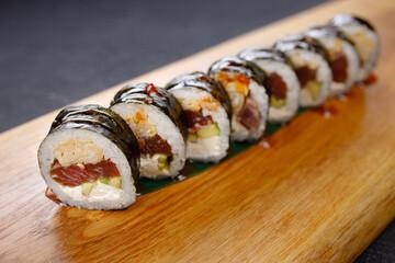 Fototapeta Seafood delicatessen menu, salmon maki sushi rolls obraz