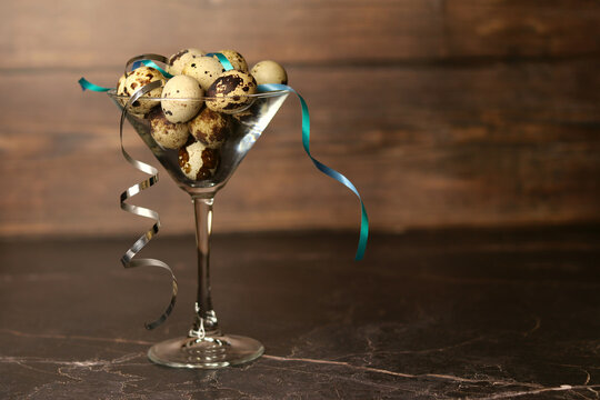 Quail eggs in a martini glass and chicken eggs