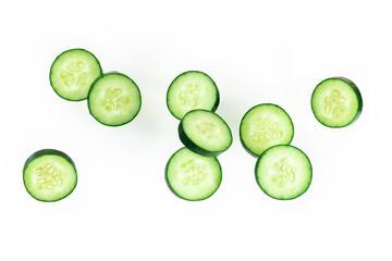 Fototapeta Cucumber slices, levitating on a white background