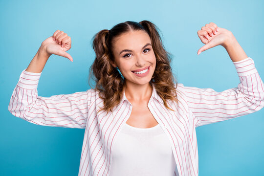 Portrait of attractive cheerful brown-haired girl pointing at herself success isolated over bright blue color background