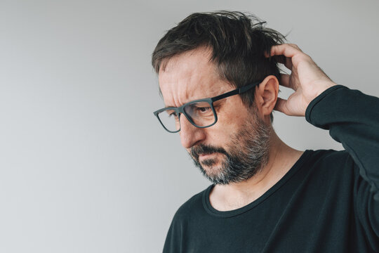 Forgetfulness - forgetful mid-adult man with eyeglasses