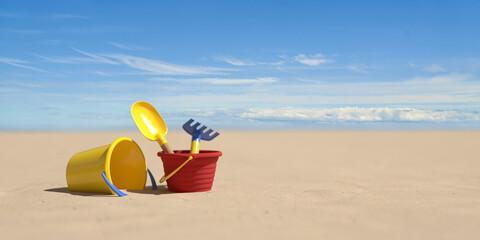 Fototapeta Urlaub am Strand im Sommer mit Eimer und Schaufel