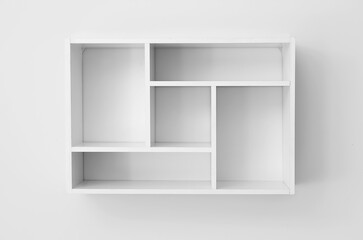 Fototapeta Modern empty shelf hanging on light wall obraz
