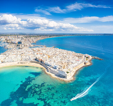 White sand beach washed by the turquoise sea surrounding Gallipoli, aerial view, Lecce province, Salento, Apulia, Italy