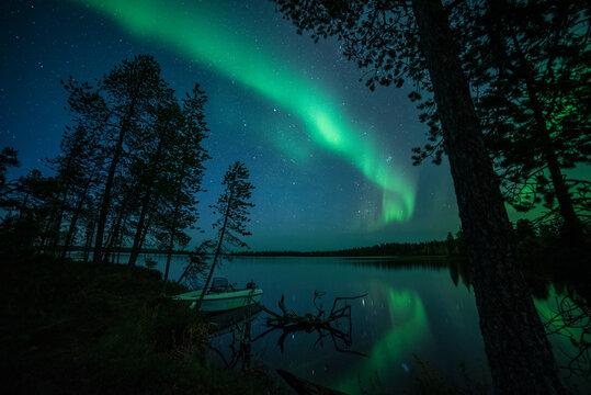 Aurora borealis (Northern Lights) reflected in Lake Pallas, Muonio, Lapland, Finland