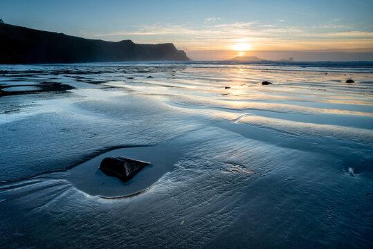 Rhossili Bay beach at low tide, at sunset, Rhossili, Gower Peninsula, Swansea, Wales, United Kingdom