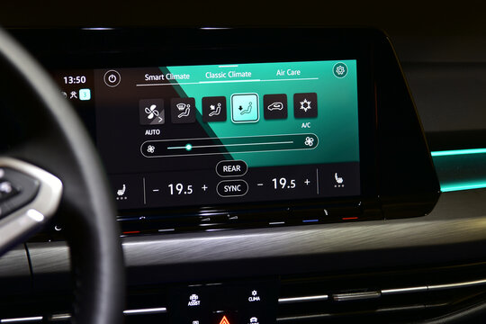 Car air conditioning panel on the luxury car console. Car climate control.