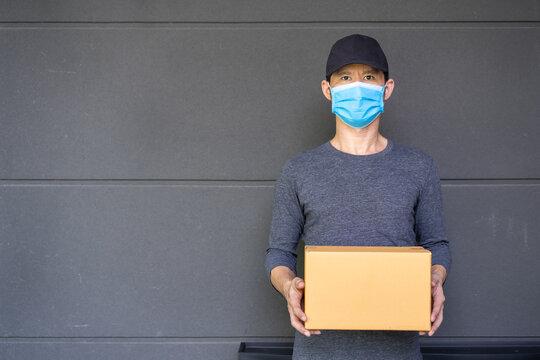 Safety mail goods delivering during epidemic. .Online shopping order under quarantine coronavirus covid-19.