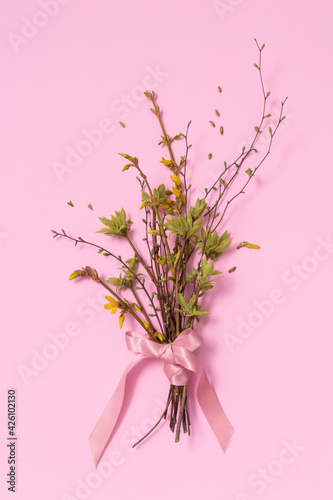 Spring bouquet on a pink background.