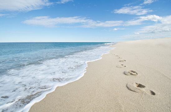 United States, Massachusetts, Cape Cod, Nantucket Island, Footprints on empty beach