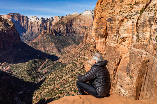 United States, Utah, Zion National Park, Senior man looking over Zion Canyon in Zion National Park