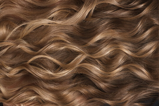 A closeup view of a bunch of shiny curls blond hair