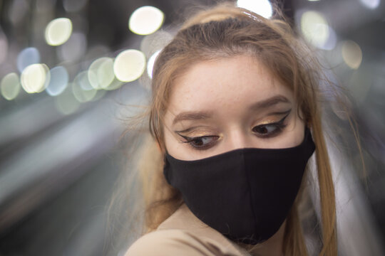 Girl wearing a protective mask amid Covid-19 pandemics in the Warsaw's subway