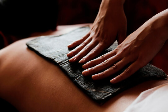 Fango massage is used for fango paraffin compresses. The photo shows a patient and a masseuse.