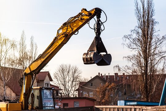 excavator operation against the background of residential buildings