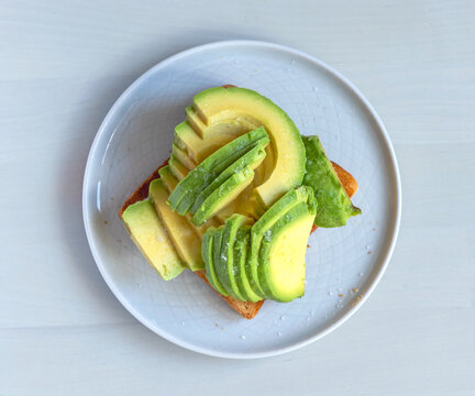 toasted bread with sliced avocado