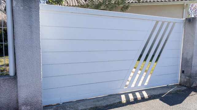 private gate in white modern portal aluminium steel door in street view of suburbs house