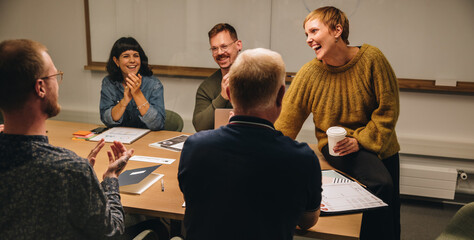 Businesswoman sharing good news in meeting