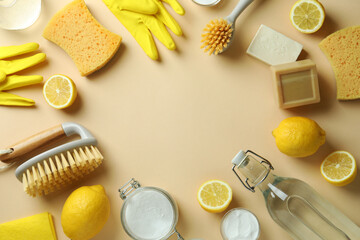 Fototapeta Cleaning concept with eco friendly cleaning tools and lemons on beige background