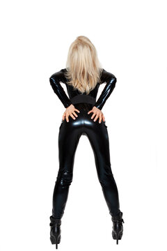 Beautiful young blonde woman with latex costume