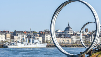 View of the city center of Nantes in France. Historic tenement houses, warship, urban landscape.