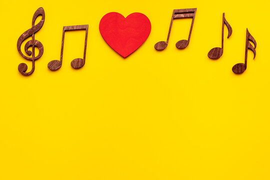 Musical notes with heart shape. Love music concept.