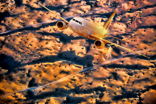 Airplane over desert during sunset in Middle East
