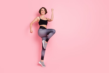Fototapeta Full body photo of young attractive sportive girl happy positive smile cross fit intense training isolated over pink color background obraz