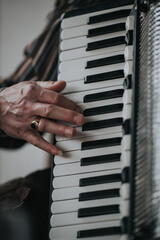 Vertical shot of a male's hand playing an Organ musical instrument