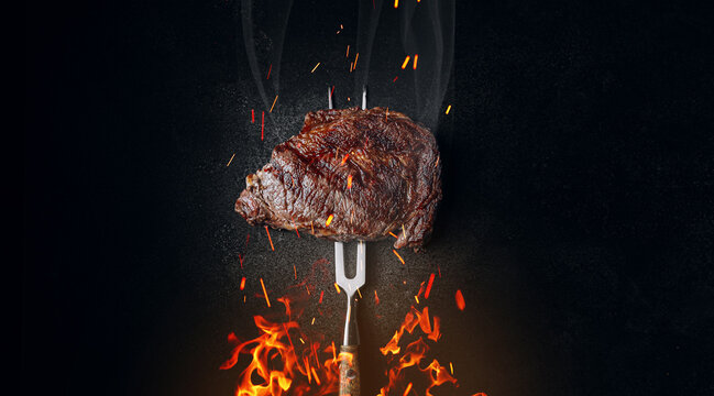 grilled beef steak on a dark background. expensive marbled beef of the highest grade fried to rare on the grill
