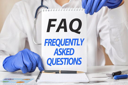 doctor holding a tablet with text: faq - frequently asked questions, medical concept