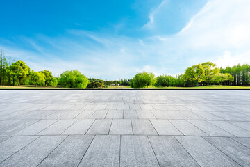 Wide square floor and green trees in natural park.