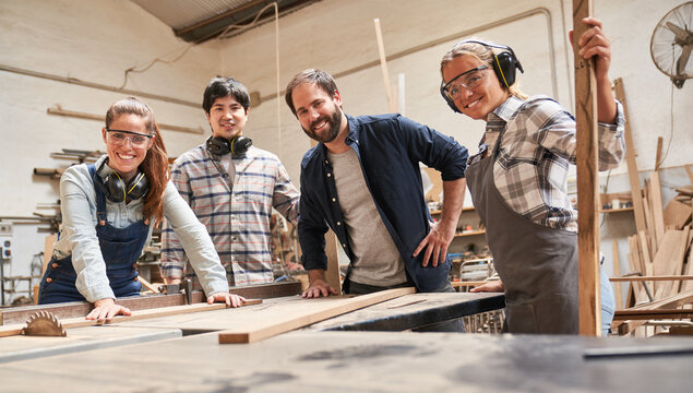 Group of craftsmen, trainees and trainers