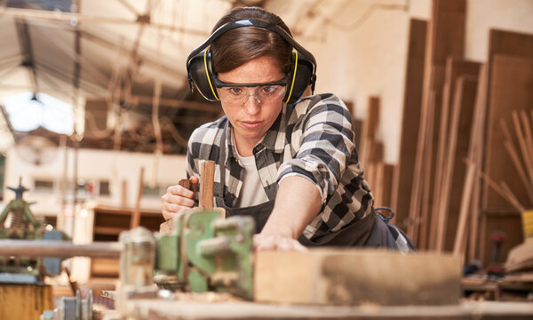 Woman as a carpenter or craftsman in workshop