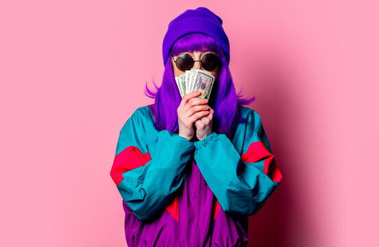 Stylish white girl with purple hair and 80s tracksuit hold cash money