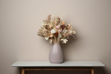 Obraz Beautiful dried flower bouquet in ceramic vase on white table near light grey wall - fototapety do salonu