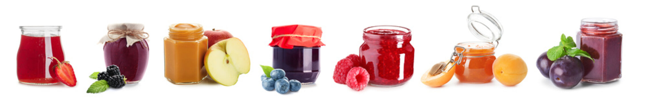 Different fruit jams in jars on white background