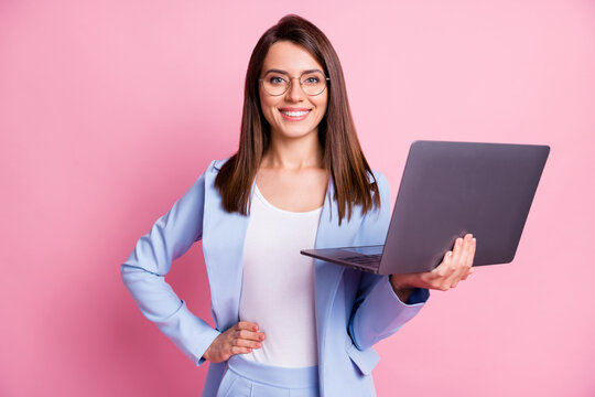 Photo of young attractive business woman happy smile hold laptop isolated over pink color background