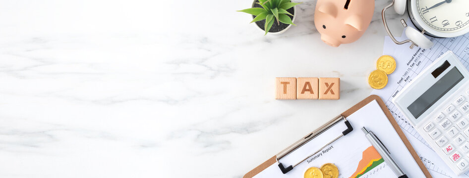 Top view of calculating and paying tax concept on marble white table.