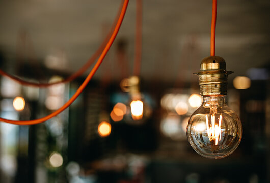Selective focus shot of a light bulb with bokeh effects in the background