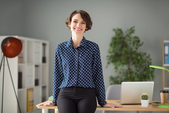 Portrait of attractive cheerful girl hr leader director real etate agency broker at work place station indoors