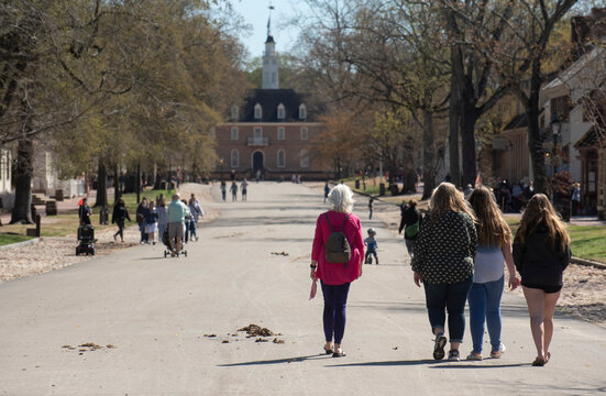 A group of female tourists explore historic Colonial Williamsburg, VA in the Spring.