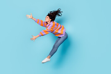 Full length body size view of pretty talented cheerful wavy-haired girl jumping dancing moving...