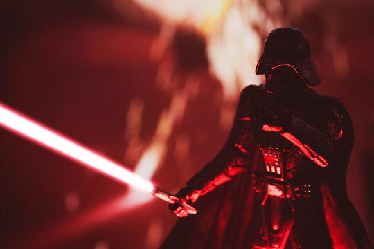 NEW YORK USA: APRIL 14 2021: Star Wars Sith Lord Darth Vader with lightsaber battling Rebels - Hasbro action figure